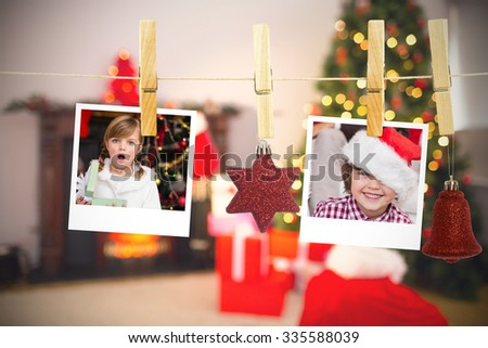 Hanging christmas photos against christmas at home