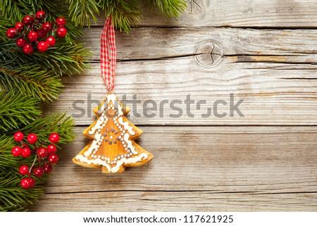 Hanging christmas tree on rustic wood