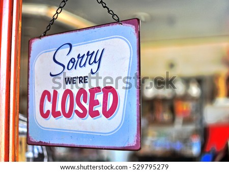 Hanging closed sign in the street shop #529795279