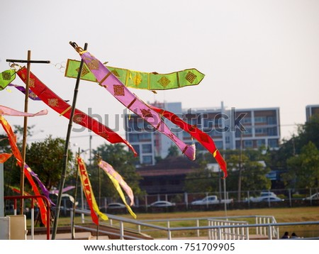 hanging decorative flags as decorative art object and cultural ornament with traditional, vintage and contemporary style with fantasy in a cultural festival in KHON KAEN University, THAILAND #751709905