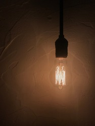 Hanging edison bulb in the dark
