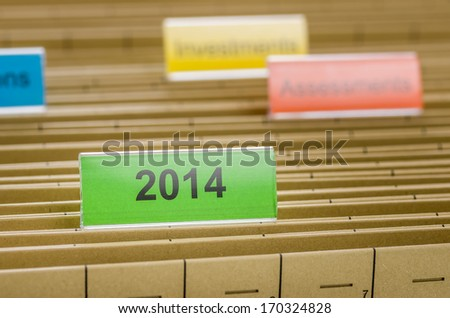 Hanging file folder labeled with 2014