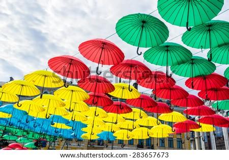 Hanging flag-coloured umbrellas show at Kyiv day. Kyiv, Ukraine.