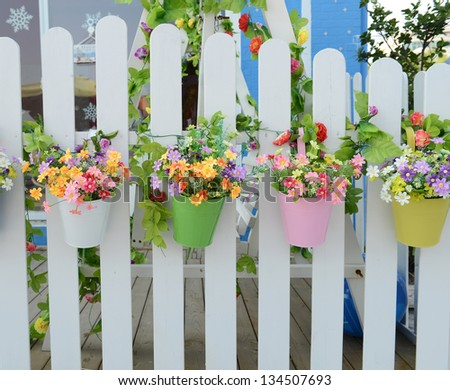 Hanging flower pots with fence stock photo 134507693 - Flower pots to hang on fence ...