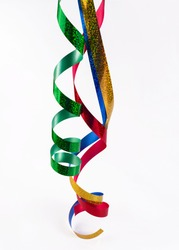 Hanging foil serpentine.Red, green, blue and gold ribbons.Festive decoration.Copy space.