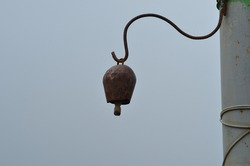 hanging iron bell on the pole