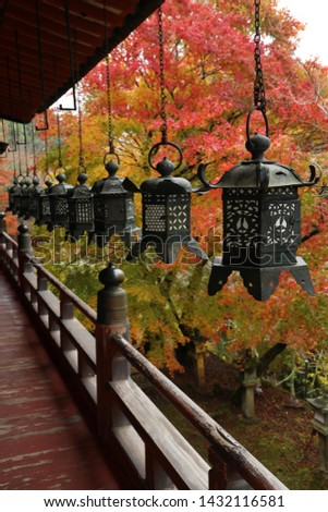 Hanging lanterns and lanterns in a stone tower with fall