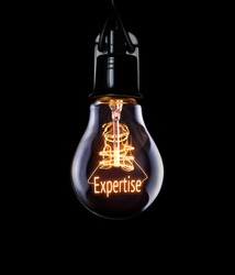 Hanging lightbulb with glowing Expertise concept.