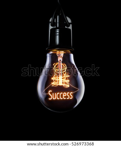 Hanging lightbulb with glowing Success concept. #526973368