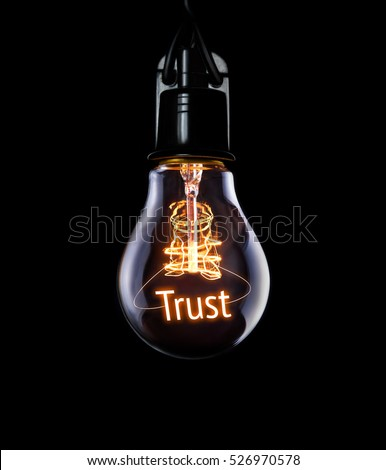 Hanging lightbulb with glowing Trust concept. #526970578