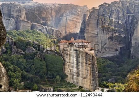 Hanging monastery at Meteora of Kalampaka in Greece during sunset