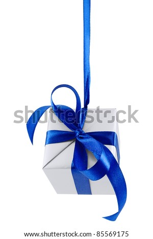 Hanging on a ribbon silver gift wrapped present with blue satin bow isolated on white