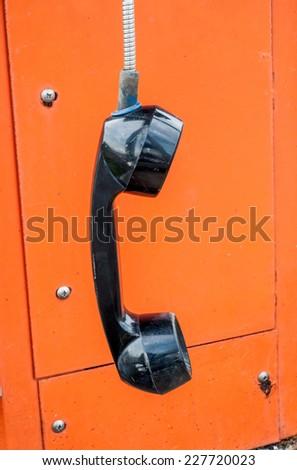 hanging public telephone