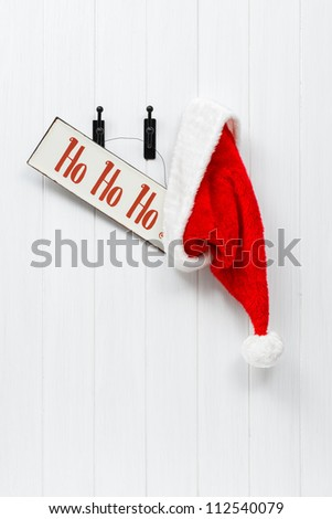 Hanging Santa Claus hat with hohoho sign