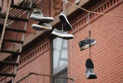 Hanging shoes from a wire.