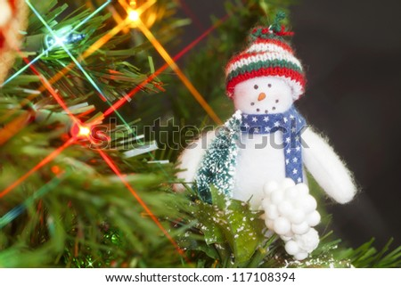 Hanging snowman on a Christmas tree