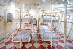 Hanging steel frame beds in old ship
