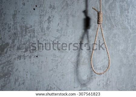 Hangman\'s loop over the concrete wall