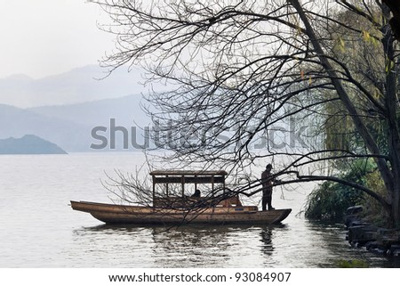 HANGZHOU - DEC. 23, 2009. Boat moors at the bank of West Lake on Dec. 23, 2009. It is a famous lake in the historic area of Hangzhou, China, and It was made a UNESCO World Heritage Site in 2011.