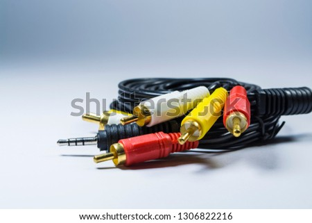 Hank of cables with multi-colored plugs a tulip. Black cord. White monophonic background.
