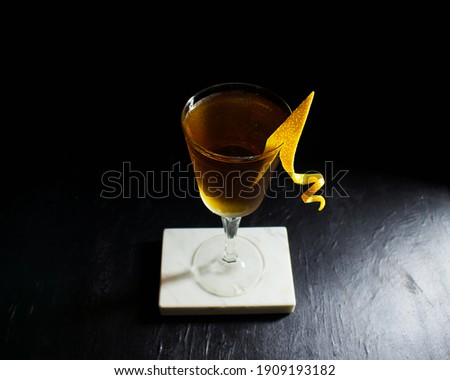 Hanky Panky gin, vermouth, Fernet cocktail with orange garnish against a dark moody black background Stock photo ©