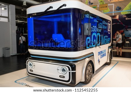 Hannover, Germany - June 13, 2018: Electric minibus e.GO Mover with option for autonomous driving on booth of company at CeBIT 2018. CeBIT is the world's largest trade fair for information technology. #1125452255