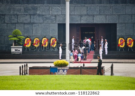 HANOI - AUGUST 8: Unidentified visitors of Ho Chi Min mausoleum on August 8, 2012 in Hanoi, Vietnam. Mausoleum was formally inaugurated on August 29, 1975.