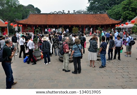 HANOI - FEB 25: Unidentified tourists visiting the Temple of Literature in Hanoi. The temple dedicated to Confucius was Vietnam\'s first National University. On Feb. 25, 2013, in Hanoi, Vietnam