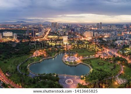 Hanoi skyline cityscape at twilight period. Cau Giay park, west of Hanoi