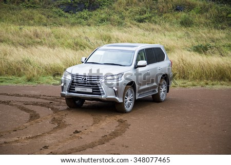 Hanoi, Vietnam - Dec4, 2015: Lexus LX 570 2016 car running on the mountain road in the rain in Vietnam. Lexus LX 570 is a luxury SUV with great off-road capabilities. #348077465