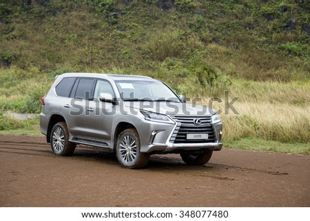 Hanoi, Vietnam - Dec4, 2015: Lexus LX 570 2016 car running on the mountain road in the rain in Vietnam. Lexus LX 570 is a luxury SUV with great off-road capabilities. #348077480