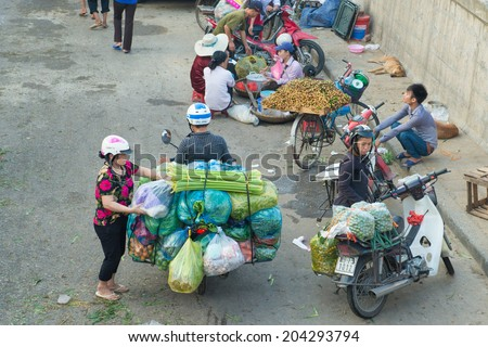 Hanoi, Vietnam - July 9, 2014: Long Bien Market is the biggest wholesale market in Hanoi. Wholesalers who carry goods urgently from Long Bien market to other markets in the city.