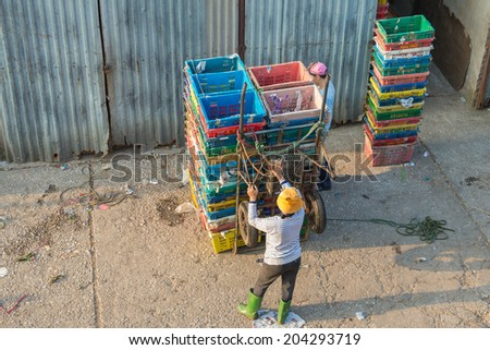 Hanoi, Vietnam - July 9, 2014: On morning, Long Bien Market is the biggest wholesale market in Hanoi. Wholesalers who carry goods urgently from Long Bien market to other markets in the city.