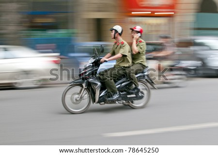 HANOI, VIETNAM - MAY 24: Motion blur of unidentified motorcycle rider in Hanoi, Vietnam on May 24, 2011. According to World Bank, there are about 1.5 million motorcycles in Hanoi (2006).