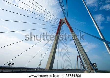 Hanoi, Vietnam - May 16, 2016: Nhat Tan bridge in the north of Hanoi. Cable-stayed bridge many spans the largest serial Vietnam. Long bridge is 9km, was put into operation from 2015. #423761506