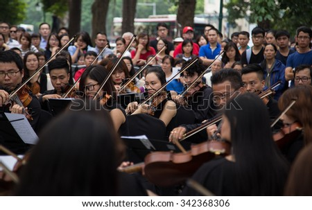 Hanoi, Vietnam - Nov 22, 2015: An outdoor live classic concert music by Asian composers performing on the side walk of an old quarter street in Hanoi capital city.