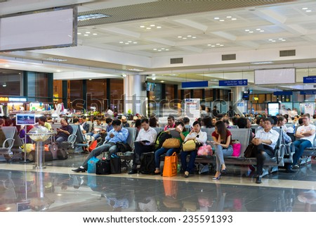Hanoi, Vietnam - Nov 27, 2014: Passengers waiting for their fly in waiting room, Noi Bai airport
