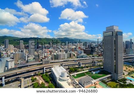 Hanshine Expressway winds through the cityscape of Kobe, Japan.