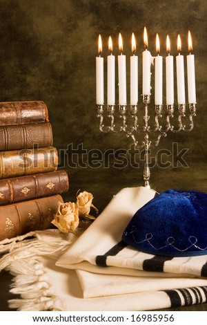Hanukkah candleholder and jewish prayer shawl, books and cap