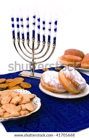 Hanukkah menorah,  donuts and coins - stock photo