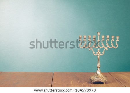 Hanukkah menorah without candles on wooden table #184598978