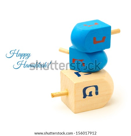 Hanukkah wooden dreidel spinning top isolated on white background