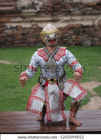 Hanuman (monkey god) somersaults in Khon or Traditional Thai Pantomime as a cultural dancing arts performance in masks dressed based on the characters in Ramakien or Ramayana Literature. #1203094852