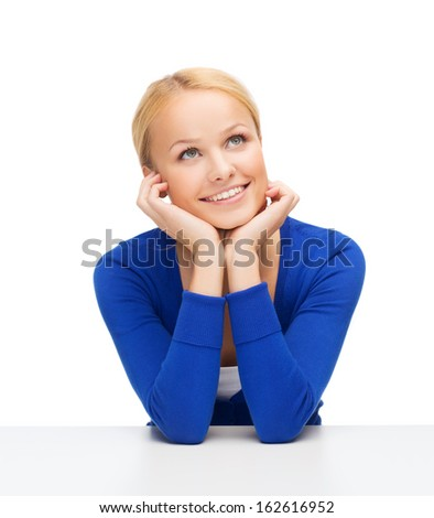 hapiness and people concept - happy smiling young woman dreaming