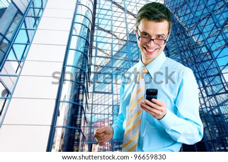 Hapiness Businessman standing on the business background