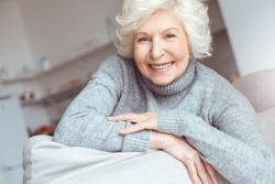Hapiness old people concept. Portrait handsome grandmother in gray sweater.
