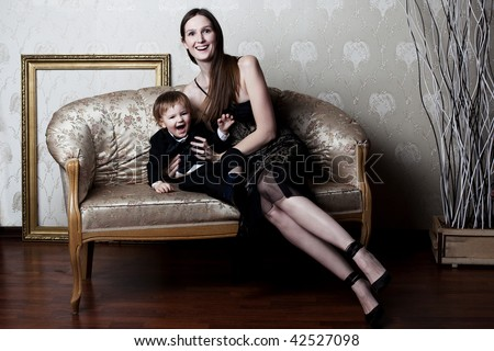 happe mother and her little son having fun