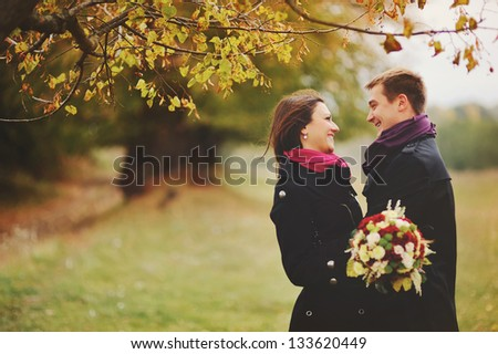 Happe young couple laughing. Sunny autumn day