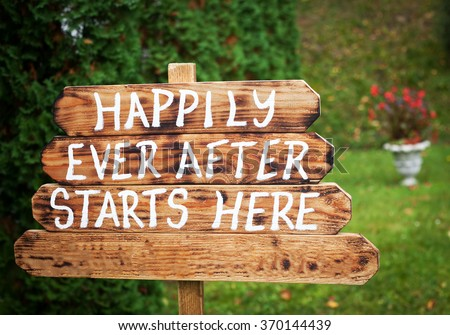 Happily ever after sign on wooden board - wedding venue or honeymoon sign