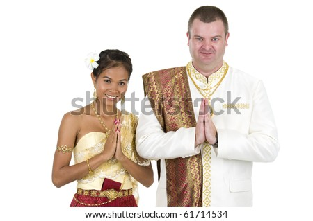 happily married couple in traditional thai wedding clothes, isolated on white background